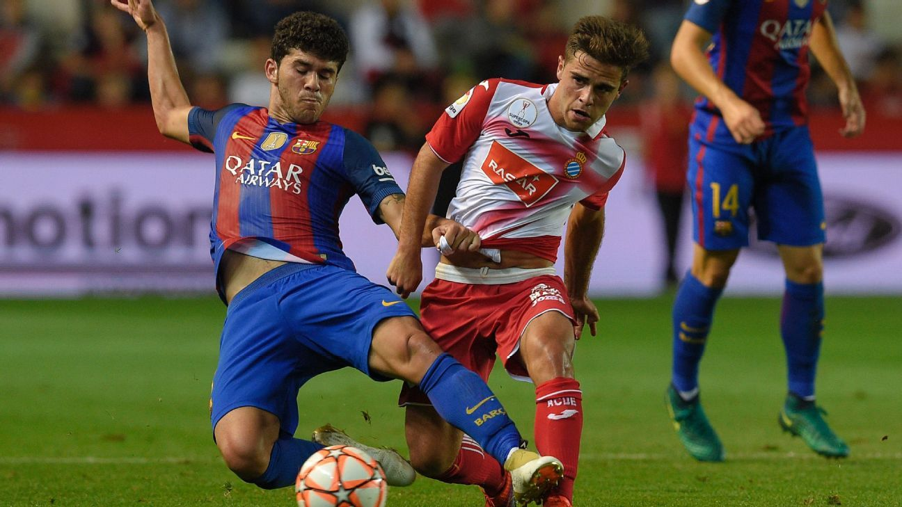 Barcelona's Carles Alena vies with Espanyol's Oscar Melendo on Tuesday.