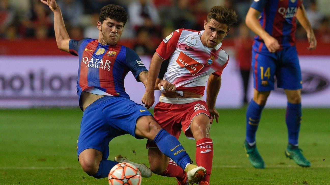 Barcelona's Carles Alena vies with Espanyol's Oscar Melendo on Tuesday.