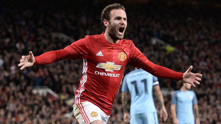 Juan Mata celebrates after scoring the winner for Man United.