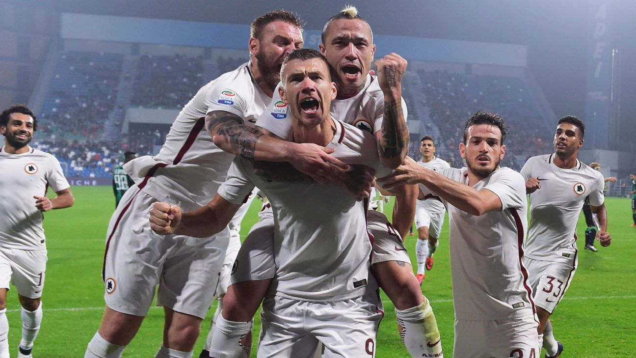 Edin Dzeko celebrates after scoring his first of two goals against Sassuolo.
