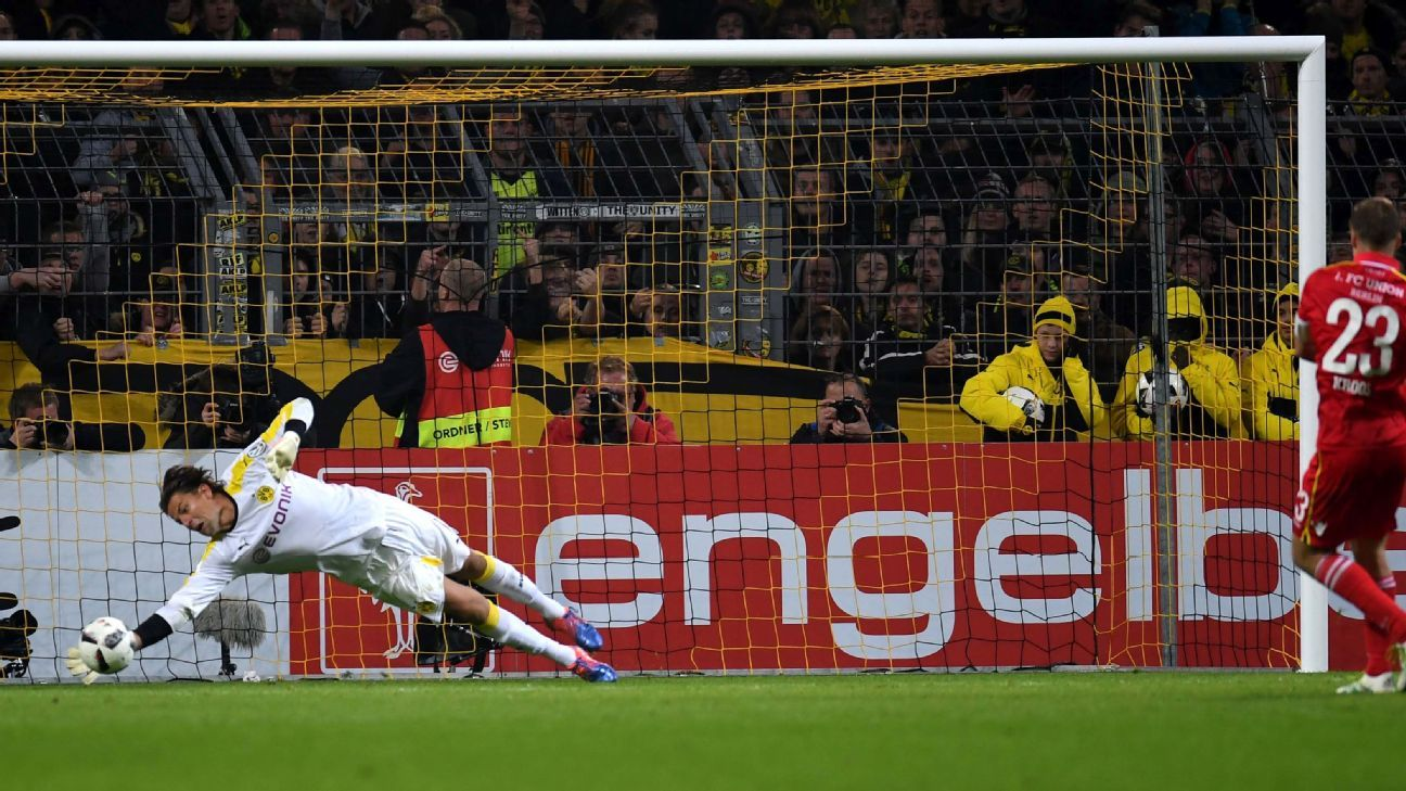 Dortmund's goalkeeper Roman Weidenfeller saves the penalty kick of Berlin´s Felix Kroos during the penalty shoot-out of the German Cup DFB Pokal second round football match BVB Borussia Dortmund v 1 FC Union Berlin in Dortmund, western Germany on October