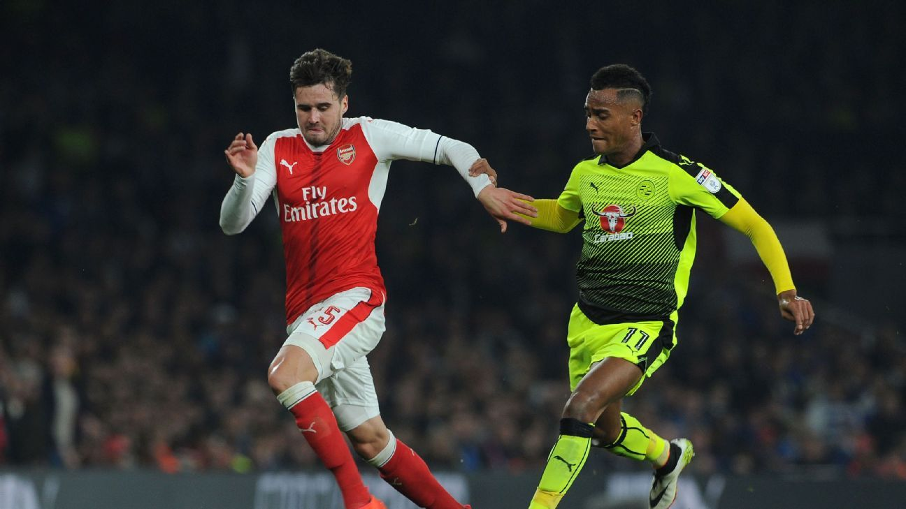 Carl Jenkison of Arsenal takes on Sandro Wieser of Reading during the match between Arsenal and Reading at Emirates Stadium on October 25, 2016 in London, England.