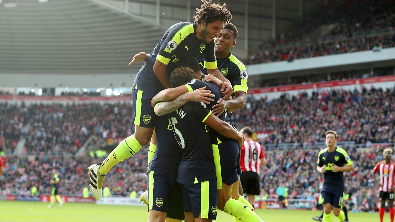 Arsenal players celebrate Alexis Sanchez's opener.