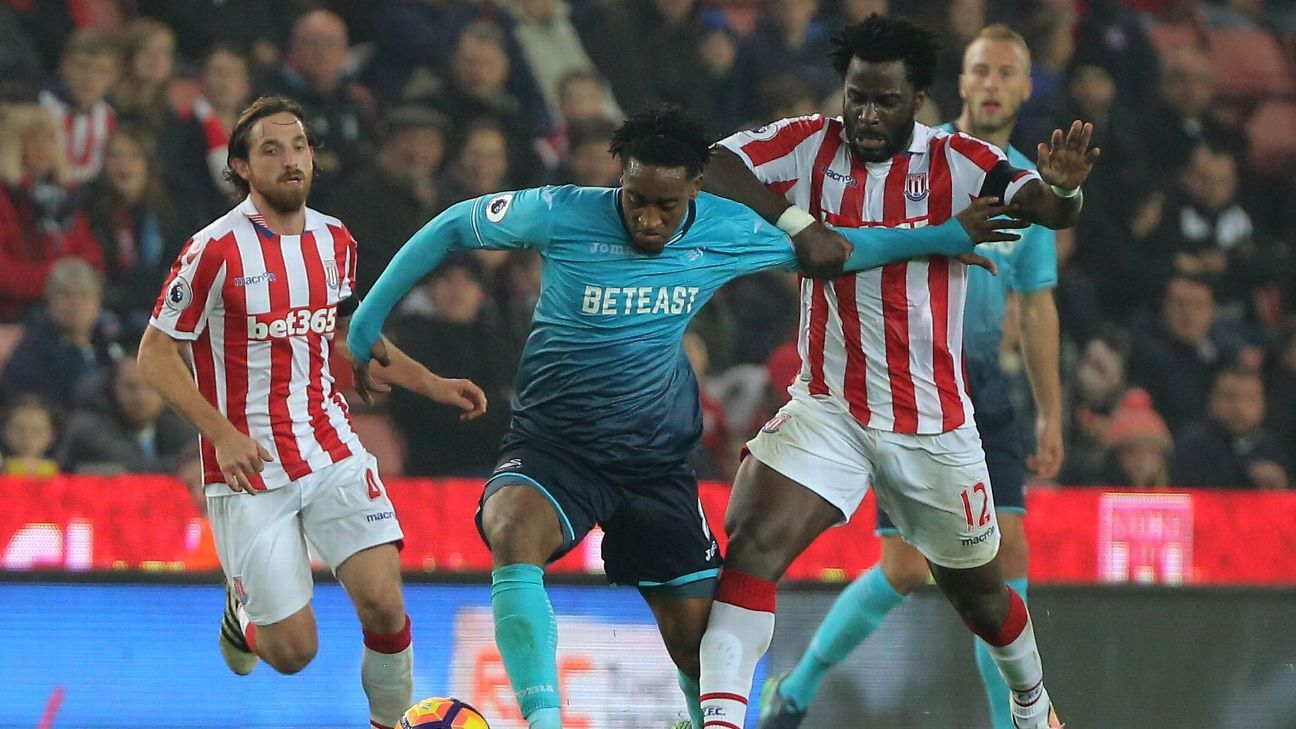Joe Allen and Wilfried Bony pressure Leroy Fer