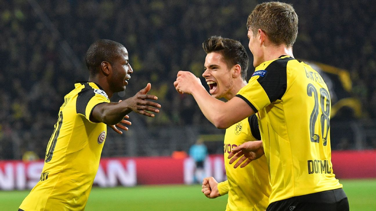 Borussia Dortmund players celebrate after Adrian Ramos scored the game's only goal in a 1-0 defeat of Sporting Lisbon.