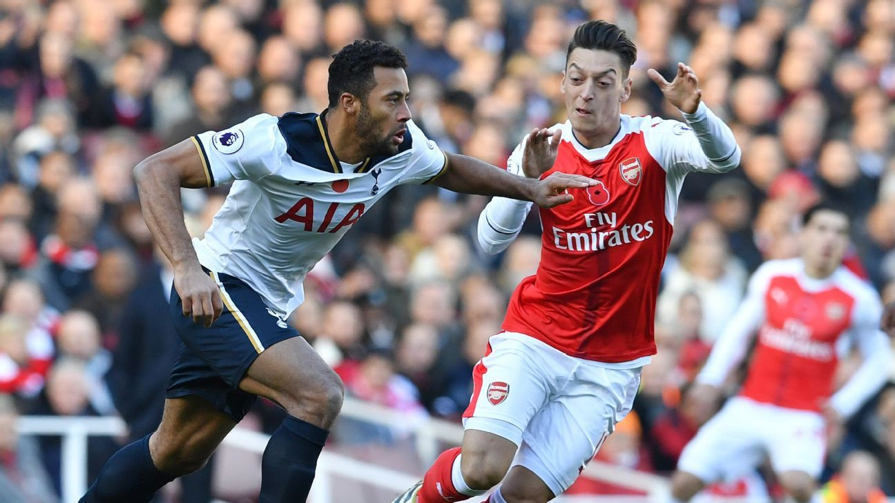 Mousa Dembele vies with Mesut Ozil during the Premier League match between Arsenal and Tottenham Hotspur.