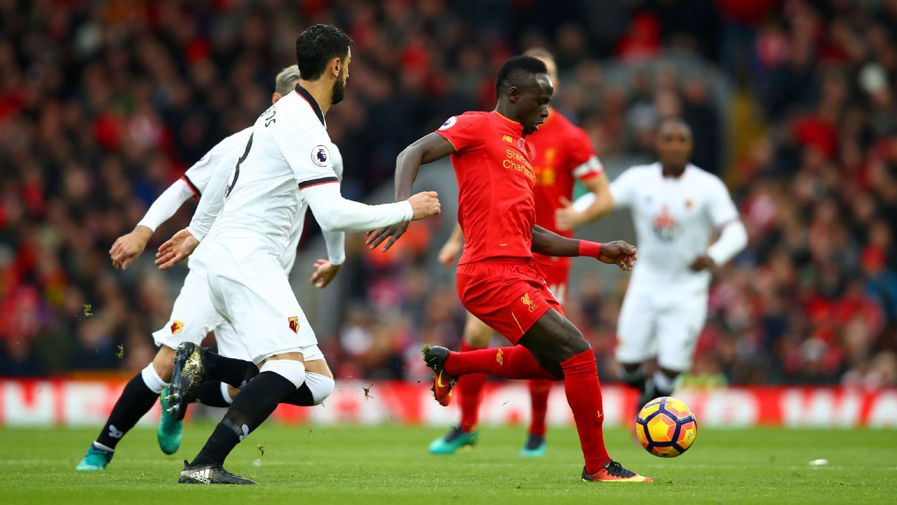Miguel Britos chases down Sadio Mane during the Premier League match between Liverpool and Watford.