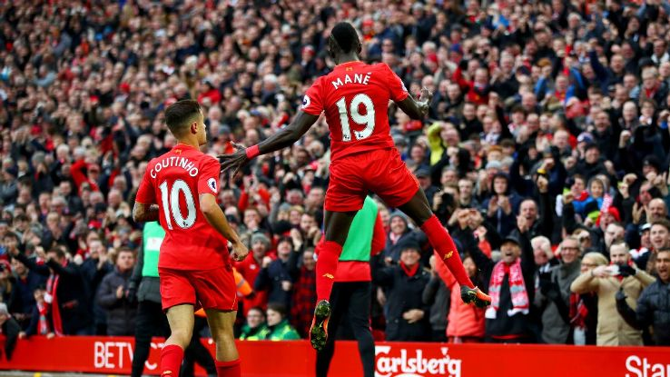 Philippe Coutinho and Sadio Mane celebrate a Liverpool goal against Watford.