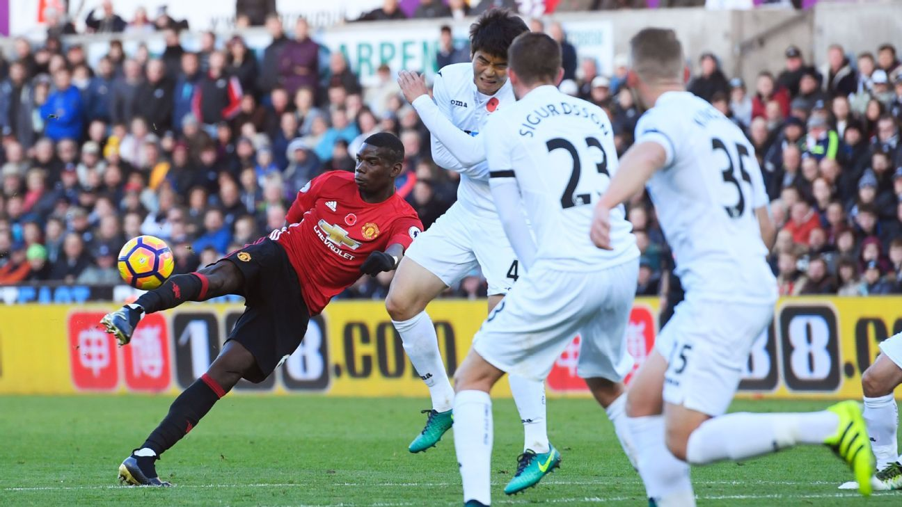 Paul Pogba of Manchester United scores his sides first goal during the Premier League match against Swansea City.