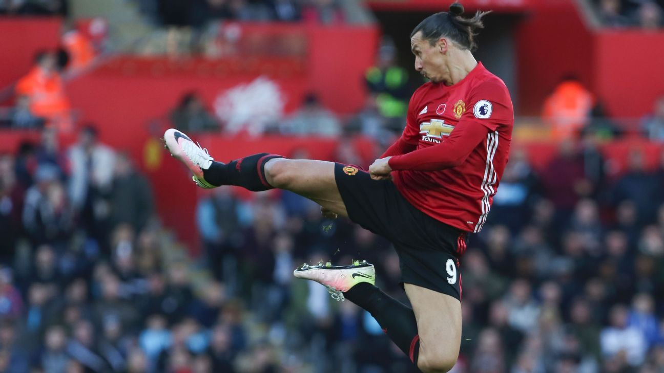 Zlatan Ibrahimovic jumps and kicks the air as he celebrates scoring his team's second goal against Swansea City.