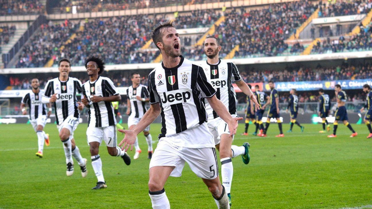 Miralem Pjanic celebrates his winner against Chievo on Sunday.
