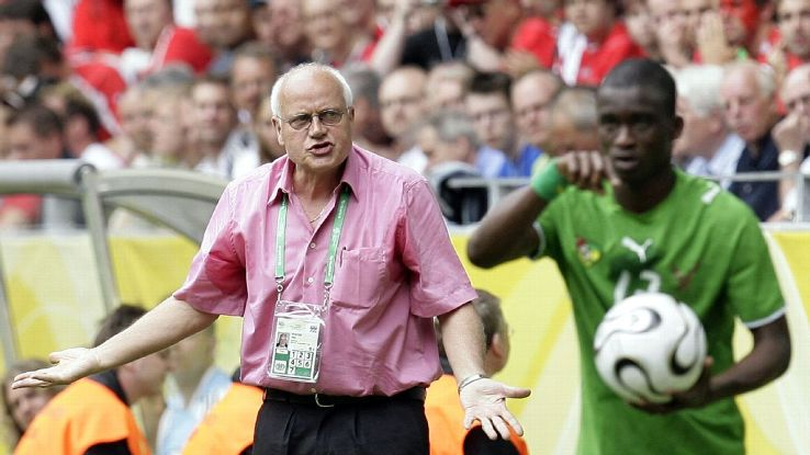 Togo's German coach Otto Pfister, left, urges his players as Richmond Forson preares to throw in a ball during the Germany 2006 Soccer World Cup, Group G, soccer match between Togo and Switzerland at Dortmund's stadium, Germany, Monday, June 19, 2006. Swi