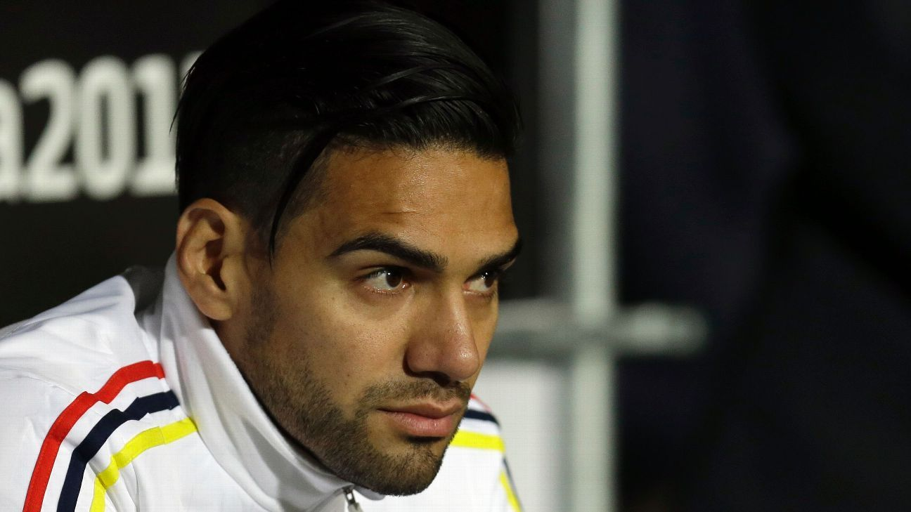 Colombia's Radamel Falcao Garcia,right, sits on the bench during a Copa America quarterfinal soccer match against Argentina at the Sausalito Stadium in Vina del Mar, Chile, Friday, June 26, 2015.