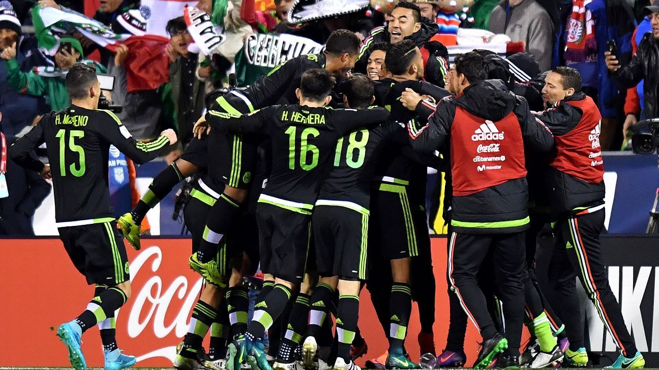 Mexico players celebrate after Miguel Layun opened the scoring against the U.S. in a 2-1 win.