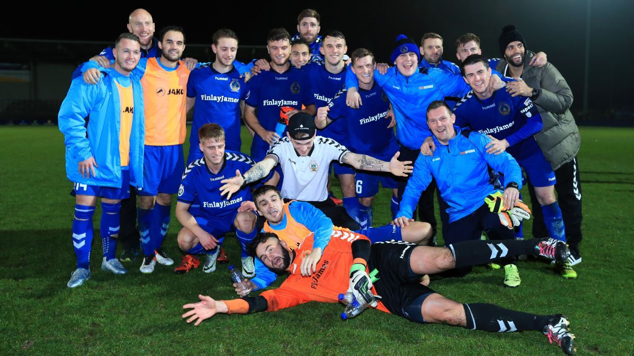 Curzon Ashton players celebrate their victory.