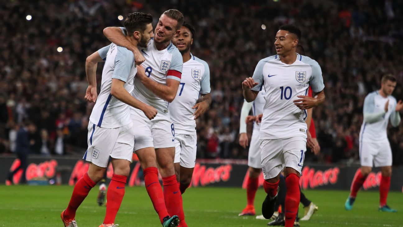 Adam Lallana celebrates after opening the scoring for England in a friendly vs. Spain.