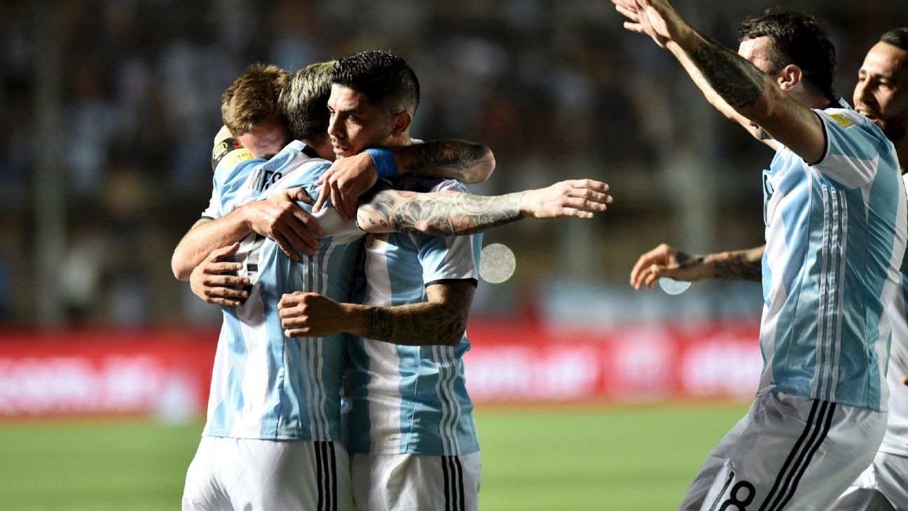 Argentina celebrate after Lionel Messi scored the opening goal in a win against Colombia.