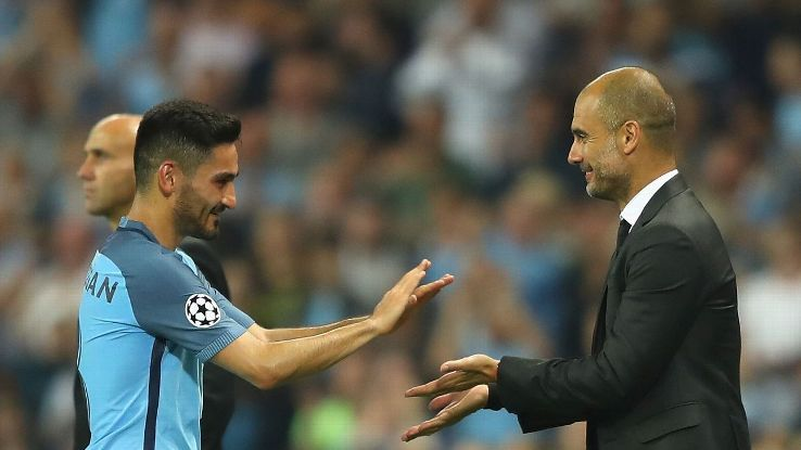 Pep Guardiola manager of Manchester City congratulates Ilkay Gundogan