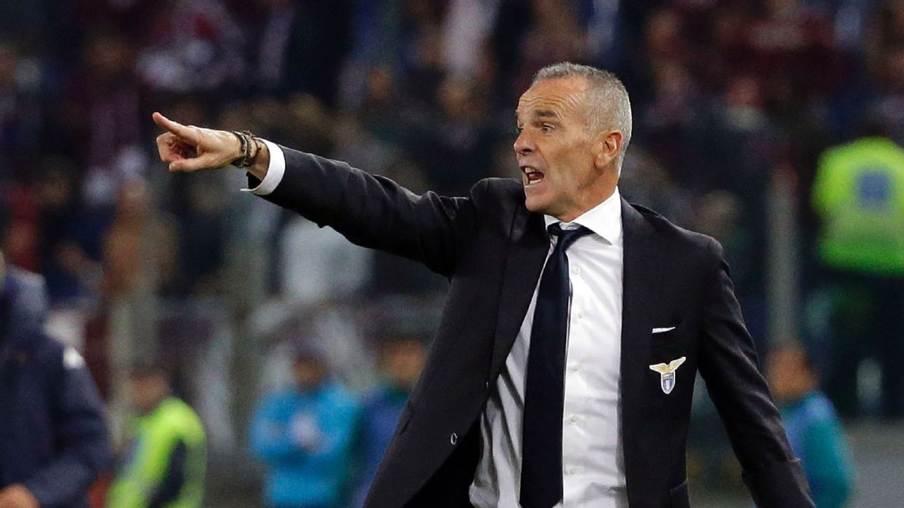 In this Sunday, Oct. 26, 2014 file photo, Lazio coach Stefano Pioli calls out to his players during a Serie A soccer match between Lazio and Torino, at Rome's Olympic Stadium. According to reports Monday, Nov. 7, 2016, former Lazio coach Pioli is expected