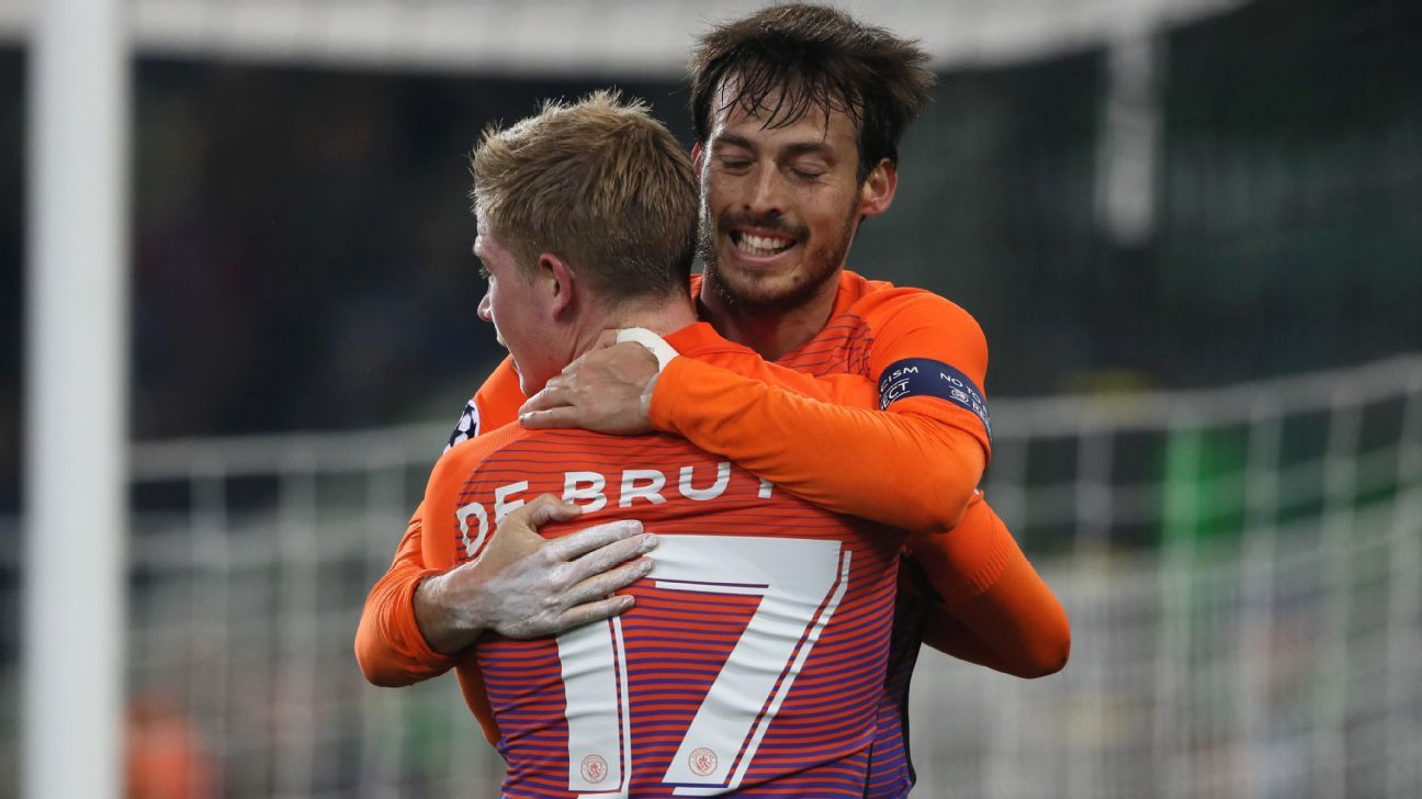 David Silva and Kevin De Bruyne celebrate after scoring a goal against Borussia Monchengladbach.