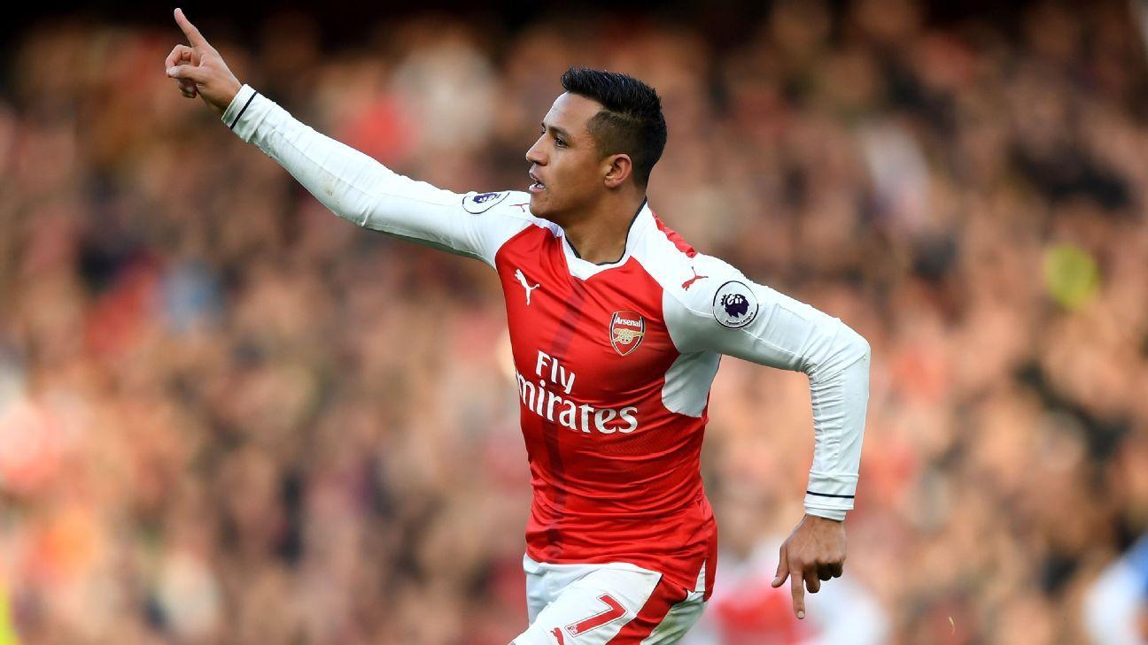 Alexis Sanchez celebrates his opener for Arsenal.