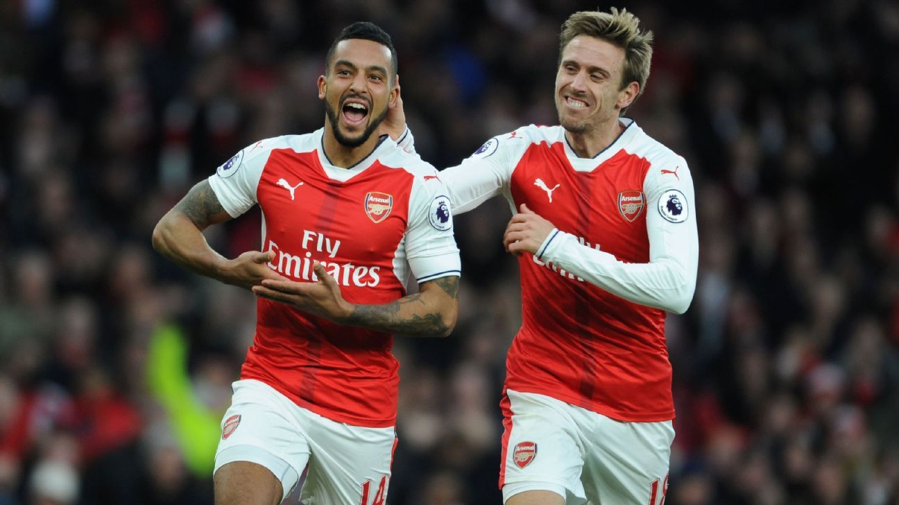 Theo Walcott celebrates his goal with Nacho Monreal.