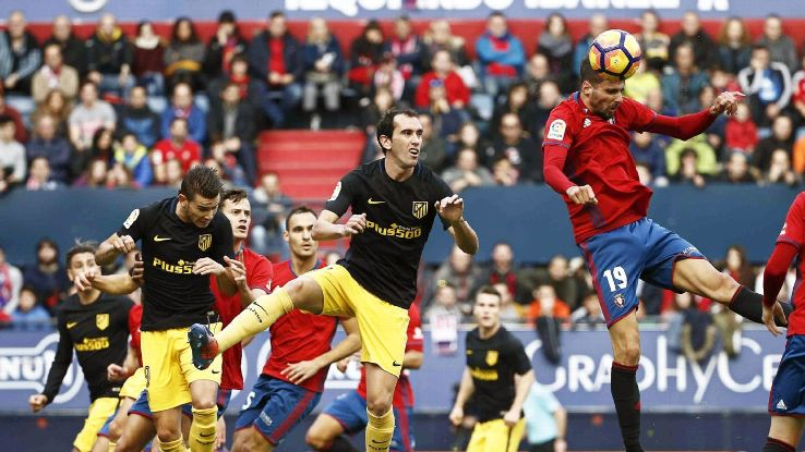 Diego Godin put Atletico Madrid in front at Osasuna.