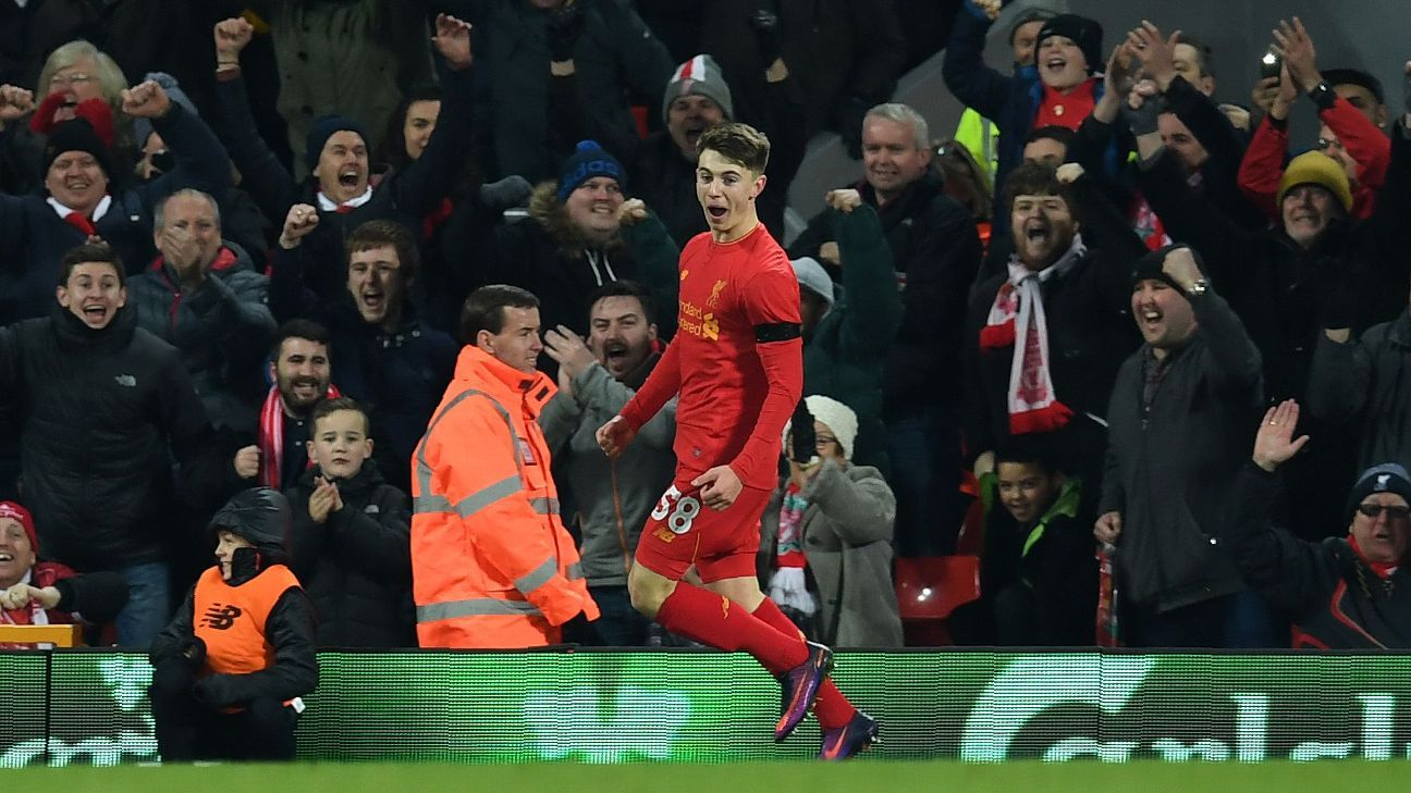 Liverpool striker Ben Woodburn celebrates after scoring his first senior side goal for the club.