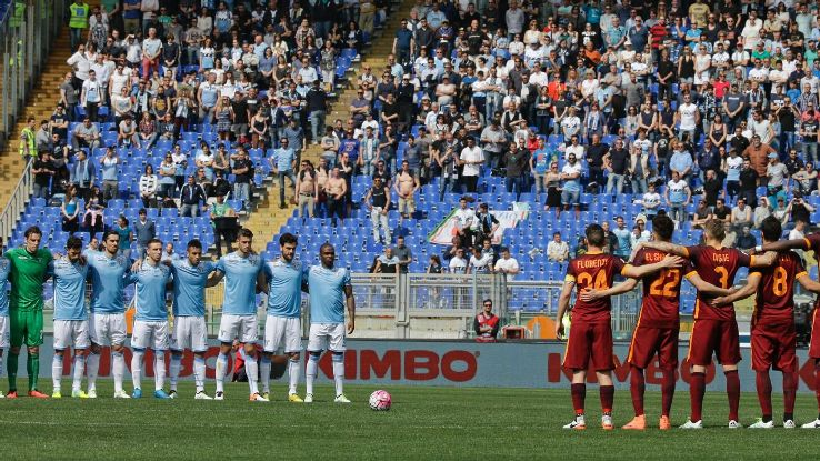 Lazio, left, and Roma teams observe a minute of silence to honor long-time coach and player Cesare Maldini, prior to a Serie A soccer match at Rome's Olympic stadium, Sunday, April 3, 2016. AC Milan has announced the death of long-time coach and player Ce