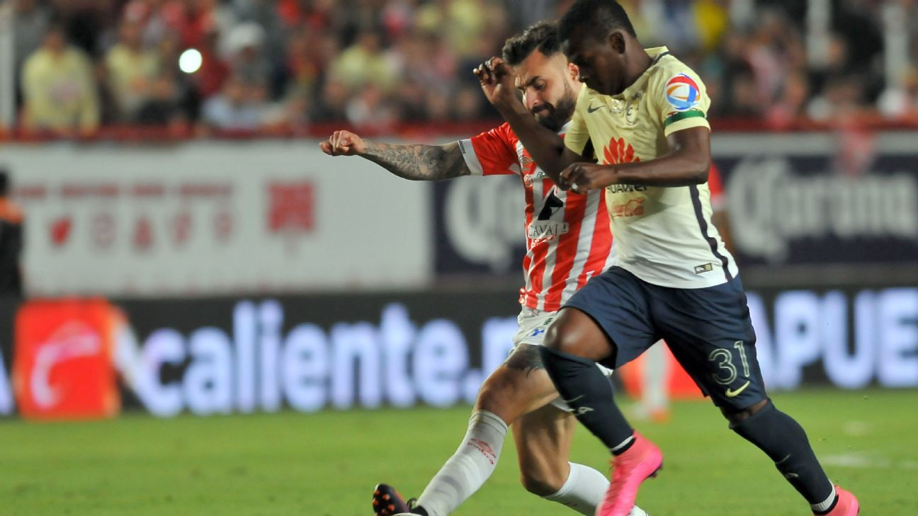 Luis Gallegos, left, of Necaxa vies for the ball with Carlos Quintero of America during the Liga MX playoffs.