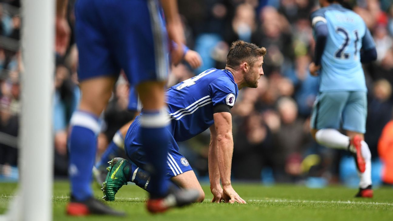 Gary Cahill reacts after turning the ball into his own net.
