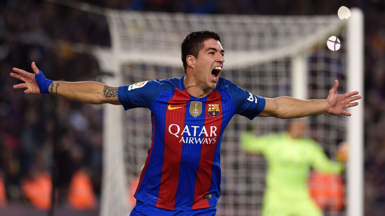 Luis Suarez celebrates his winner for Barcelona at the Camp Nou.