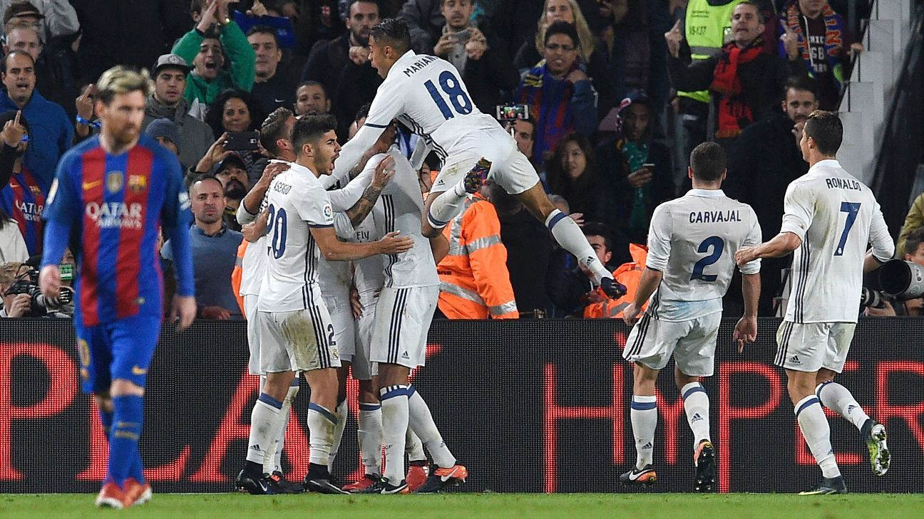 Real Madrid celebrate Sergio Ramos' equaliser.