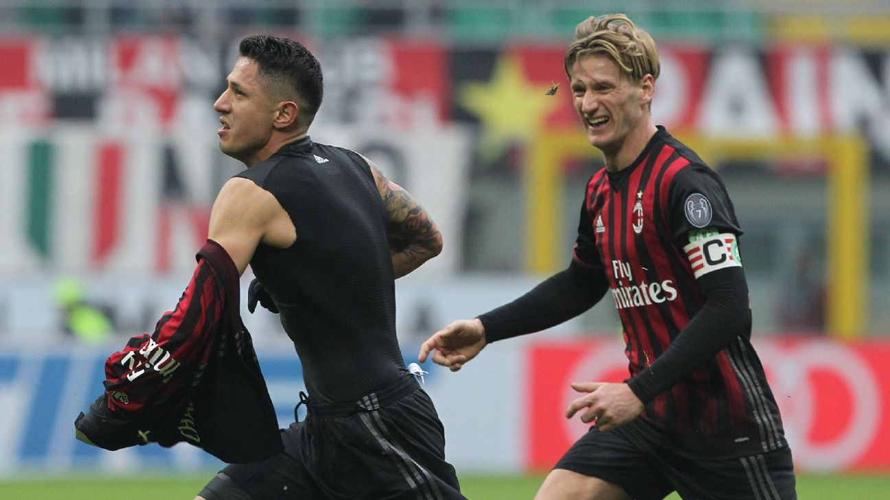 Gianluca Lapadula celebrates his winner for AC Milan.