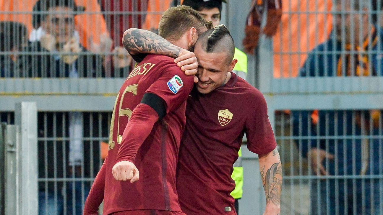 Daniele De Rossi celebrates with Radja Nainggolan during Roma's 2-0 win against Lazio.