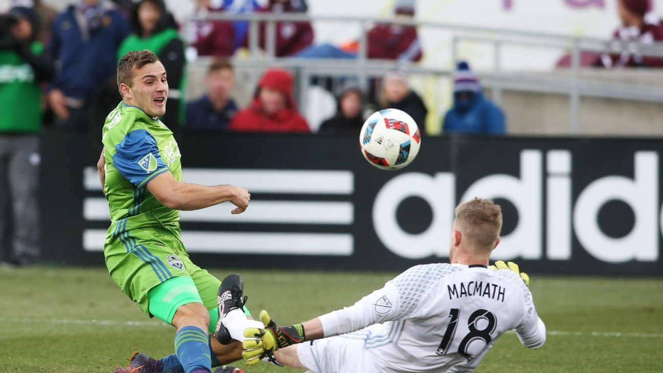 Nov 27, 2016; Commerce City, CO, USA; Seattle Sounders forward Jordan Morris (13) scores a goal past Colorado Rapids goalkeeper Zac MacMath (18) during second half of the second leg of the MLS Western Conference Championship at Dick's Sporting Goods Park.