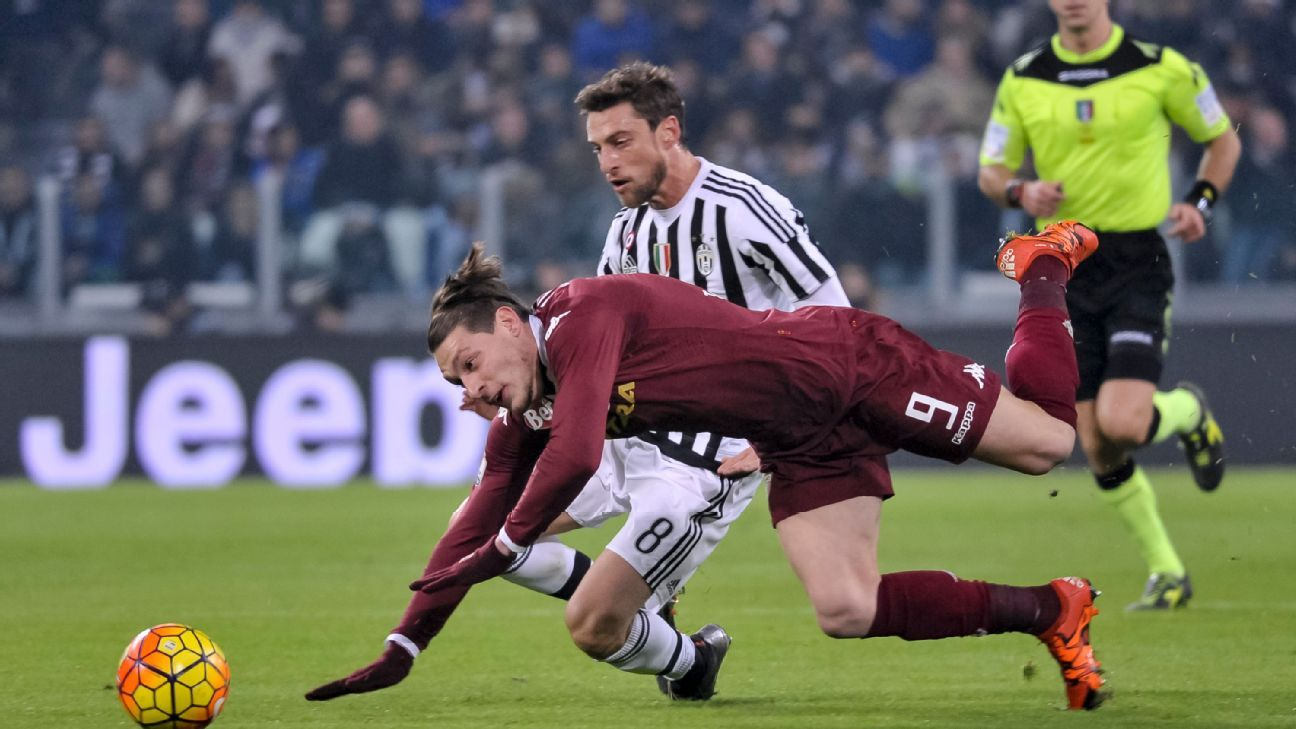 JUVENTUS STADIUM, TURIN, ITALY - 2015/12/16: Andrea Belotti (left) and Claudio Marchisio (right) fight for the ball during the Italy Cup match between Juventus FC and Torino FC. Juventus FC wins 4-0 over Torino FC.