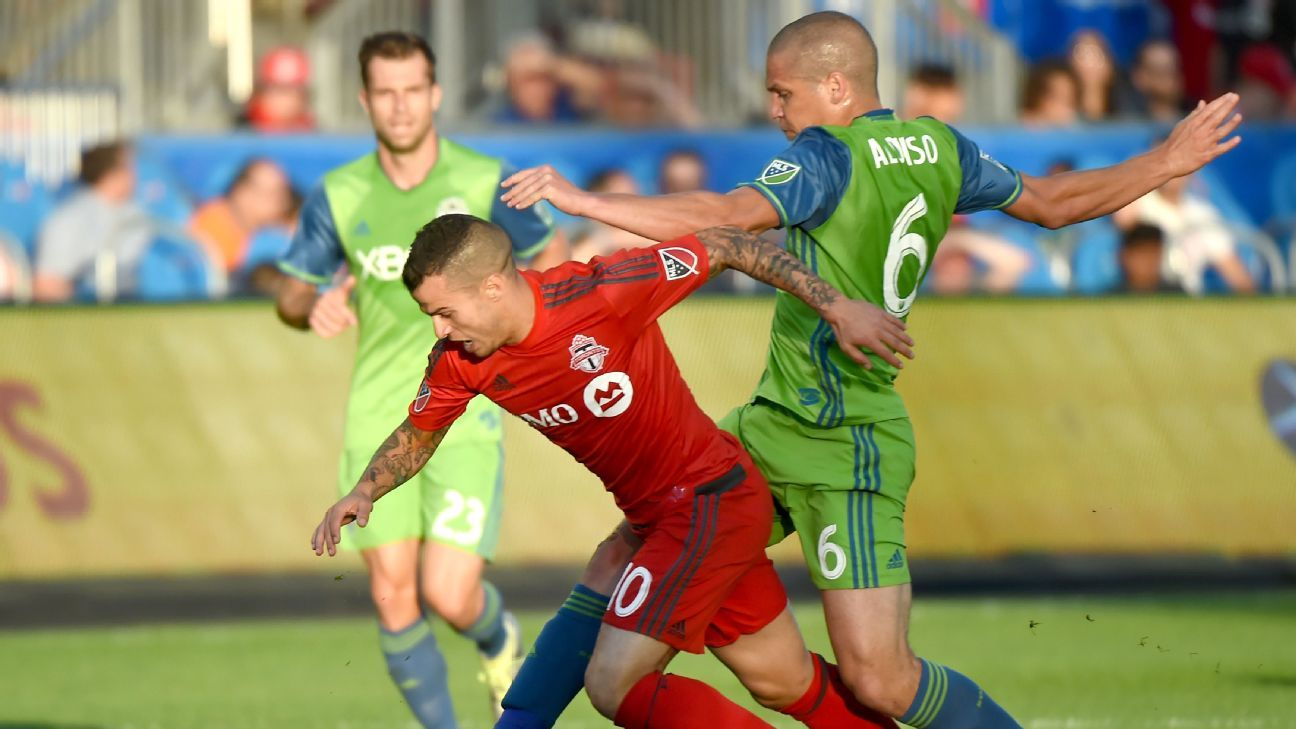 Sebastian Giovinco and Osvaldo Alonso