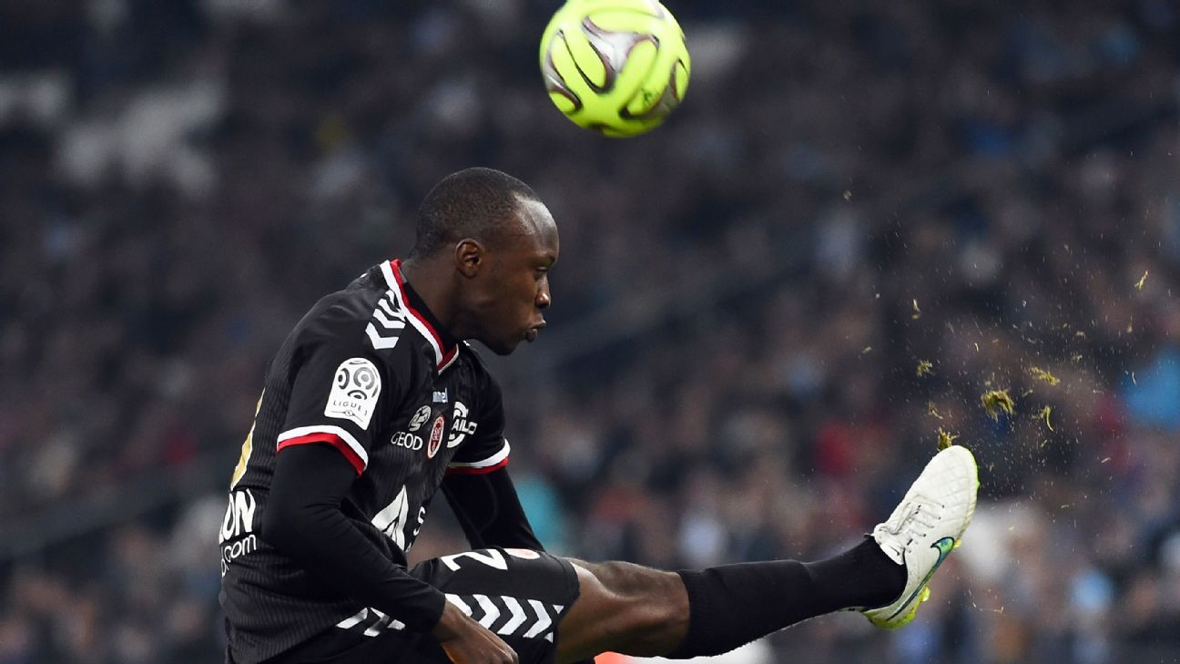 Reims' defender Antoine Conte in action against Marseille.