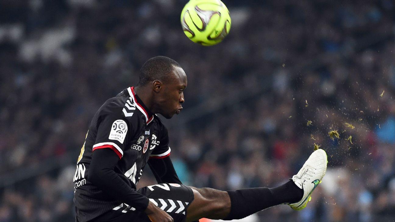 Reims' defender Antoine Conte in action against Marseille.