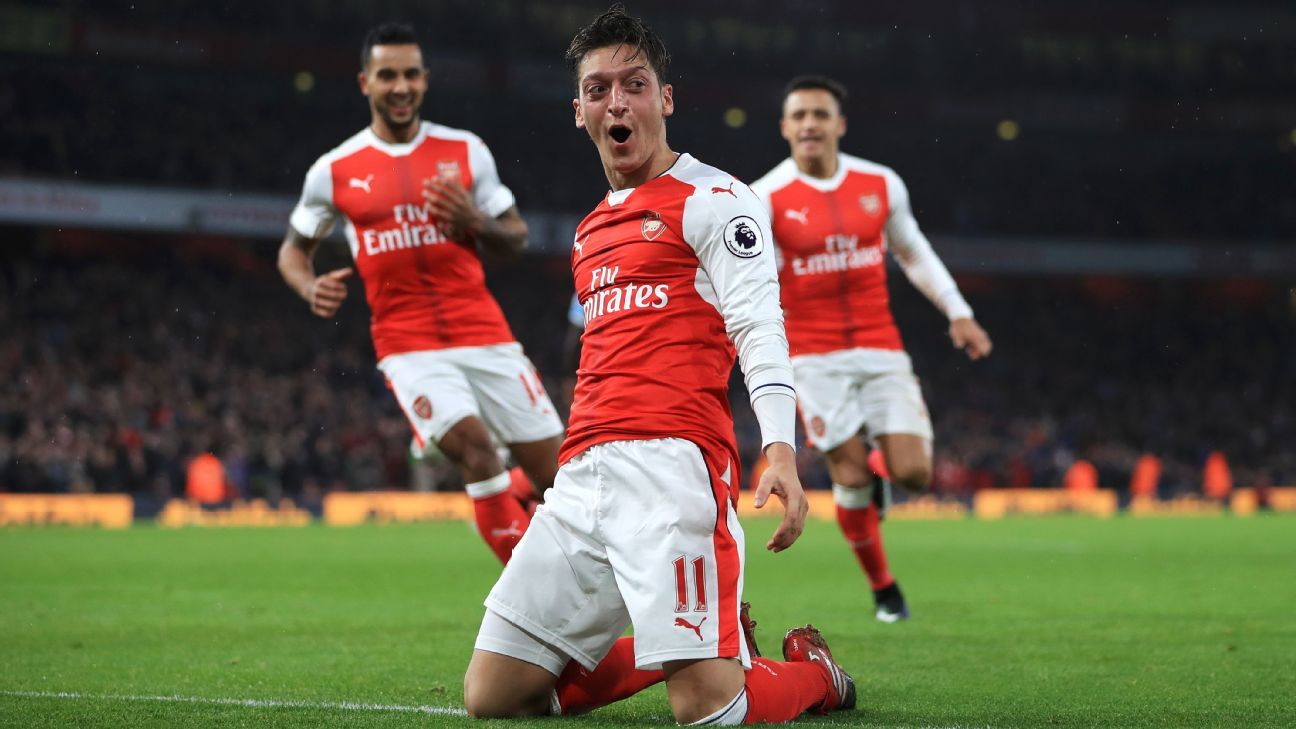Mesut Ozil celebrates after scoring Arsenal's second goal.