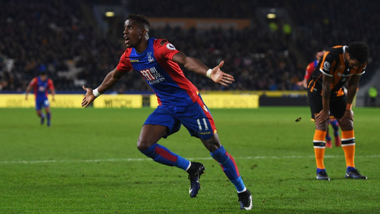 Wilfried Zaha celebrates after scoring Palace's second goal.