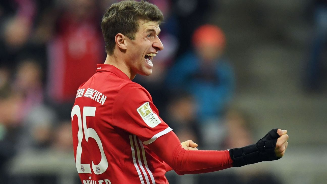Thomas Muller celebrates scoring a goal in Bayern Munich's defeat of Wolfsburg.