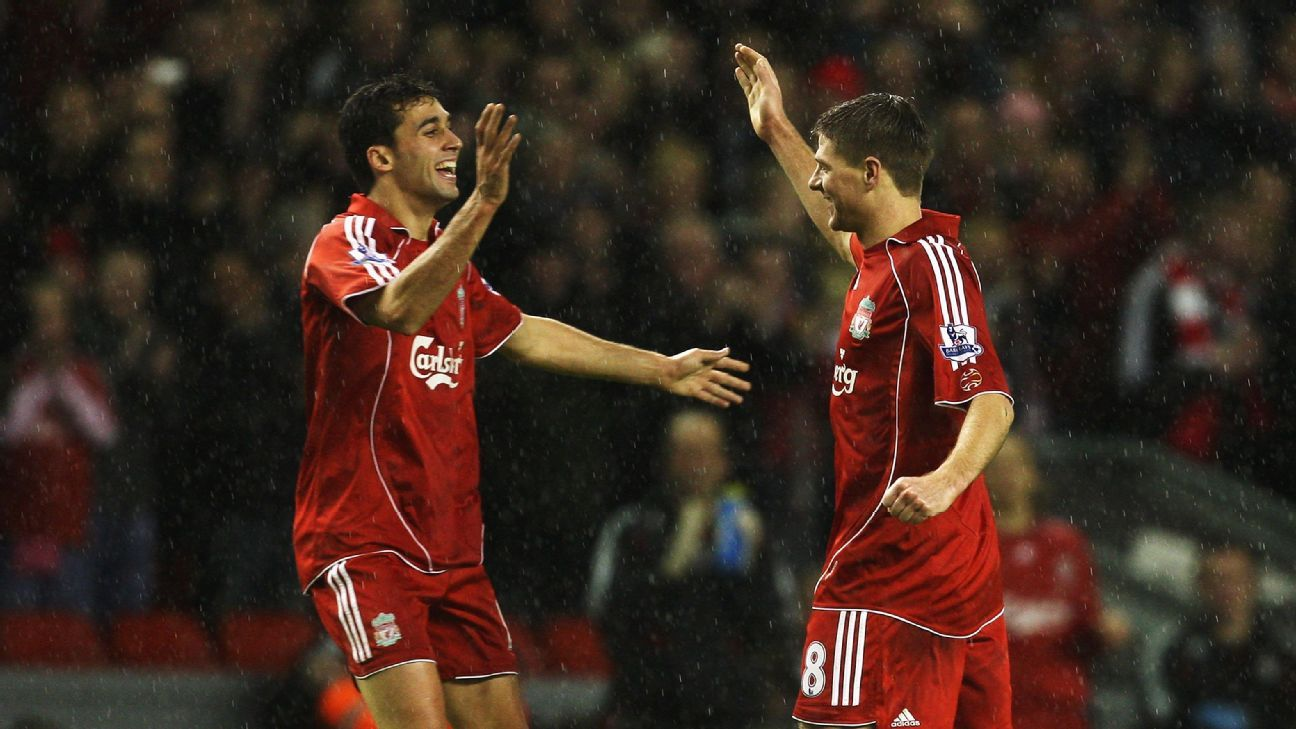 Steven Gerrard (R) of Liverpool is congratulated by teammate Alvaro Arbeloa after he scored against Luton Town in the FA Cup.