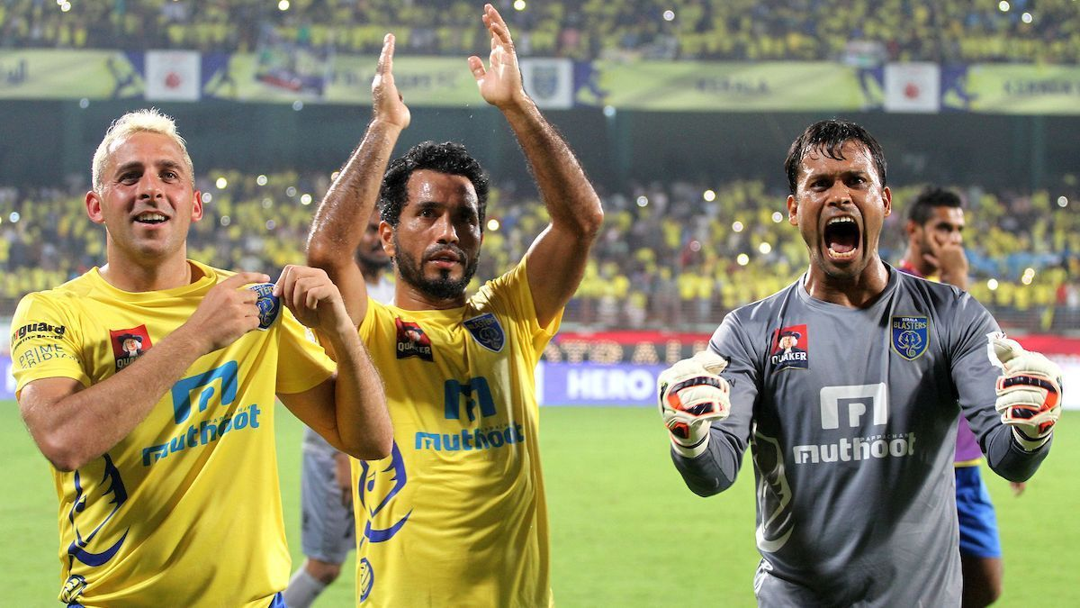 (From left) Michael Chopra, Ishfaq Ahmed and Sandip Nandy celebrate after a win over Mumbai City.
