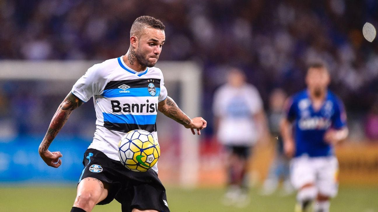 Luan, pictured in action for Gremio against Cruzeiro, has been linked with a move to Paris Saint-Germain.