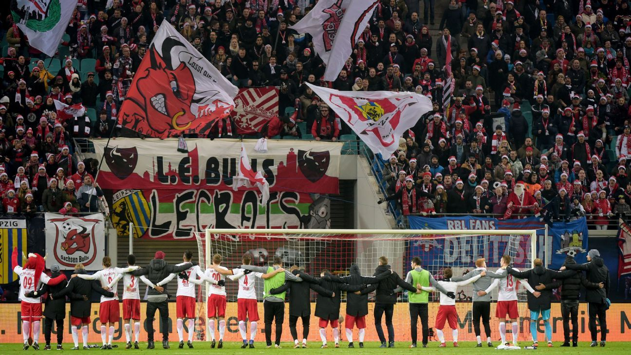 RB Leipzig players salute their fans after a 2-0 win against Hertha Berlin.