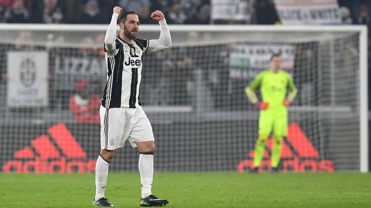 Gonzalo Higuain celebrates after opening the scoring against Roma.