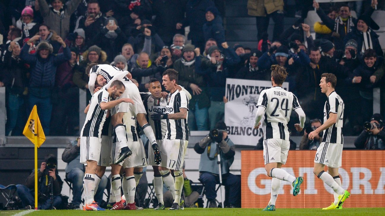 Gonzalo Higuain celebrates with Juventus teammates after scoring against Roma in Serie A.