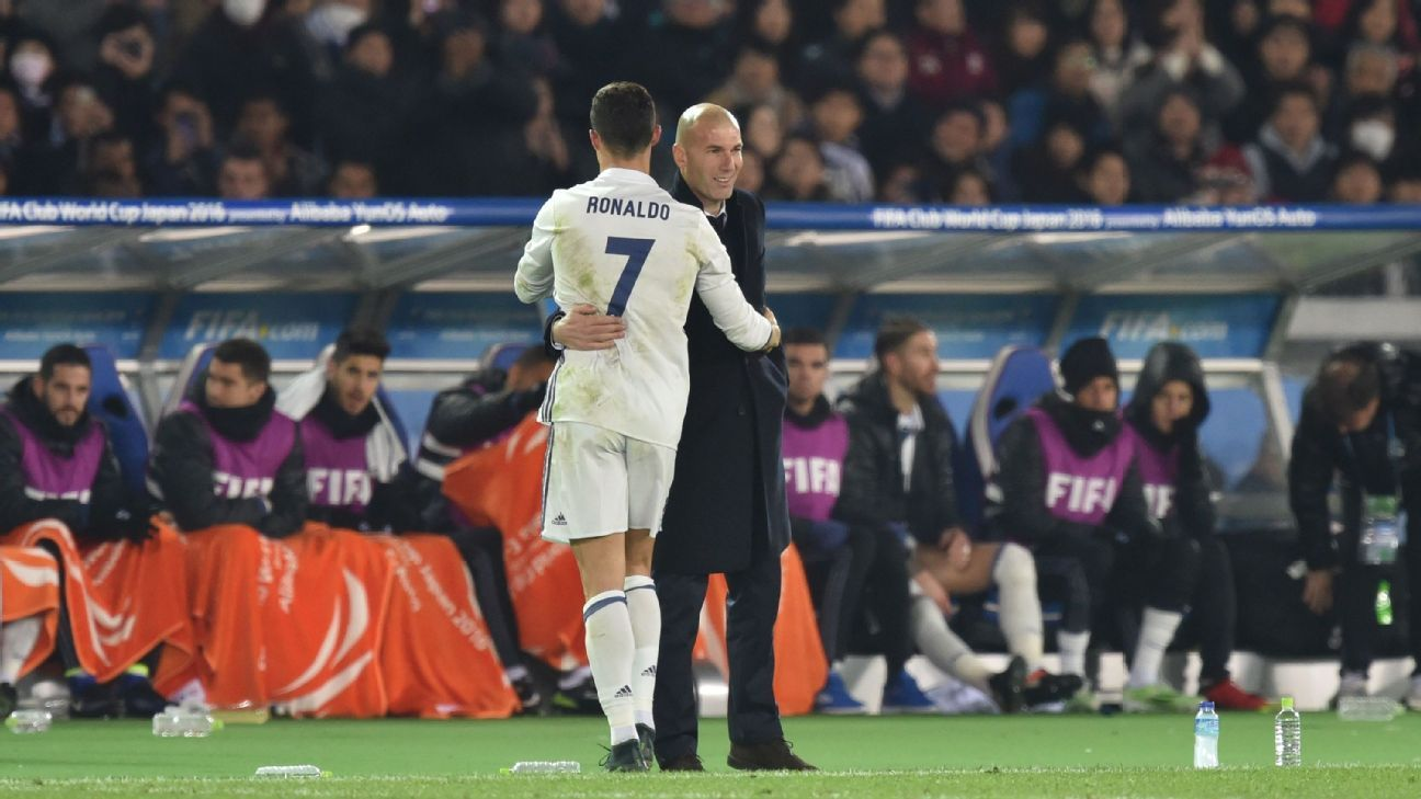 Cristiano Ronaldo is embraced by Zinedine Zidane during Real Madrid's Club World Cup victory against Kashima Antlers.